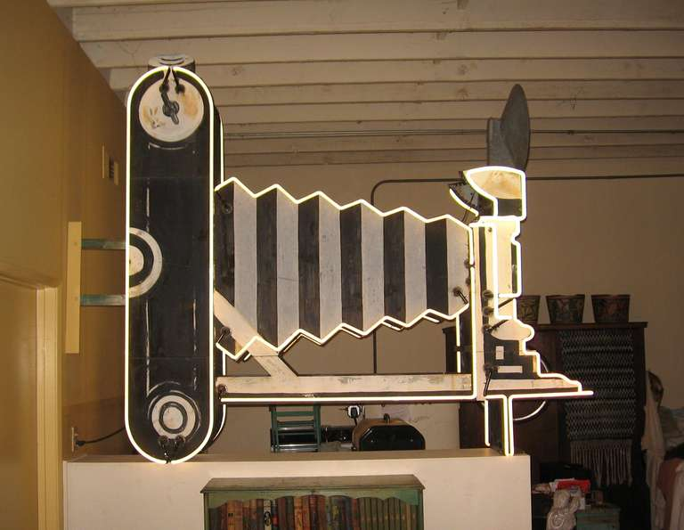 Vintage 1950 double sided neon sign patterned after a 3-A autographic Kodak Jr folding camera, the sign comes complete with all neon, original paint and a light up flash on top.   The sign was custom built for The Photo Shop on Las Vegas Blvd in