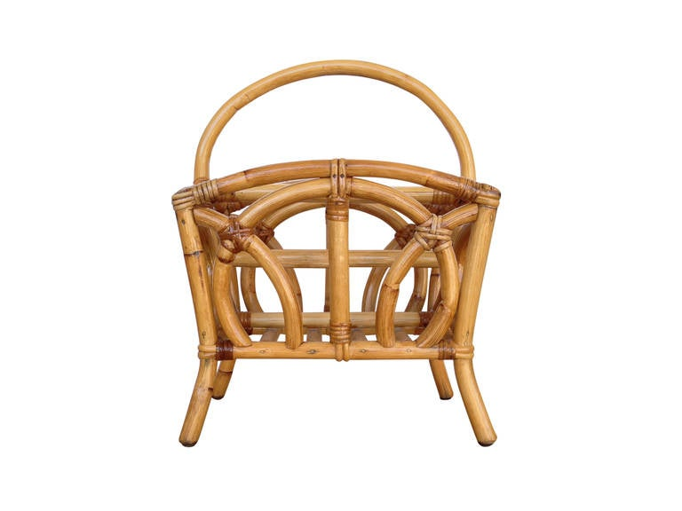 Early circa 1940 molded pole rattan Magazine Rack. Great example of early modern rattan design.  Restored to new for you.  All rattan, bamboo and wicker furniture has been painstakingly refurbished to the highest standards with the best materials.