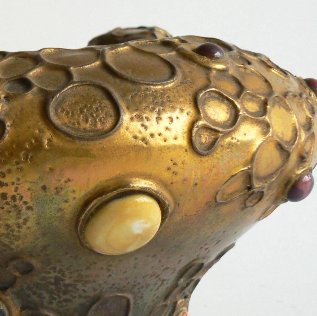 Riessner & Kessel, better known as Amphora, a Bohemian ceramics producer, introduced its Gres-Bijou series in 1904, at a moment of consumer fatigue with the Art Nouveau movement's focus on floral ornamentation.   This biomorphic series, with its