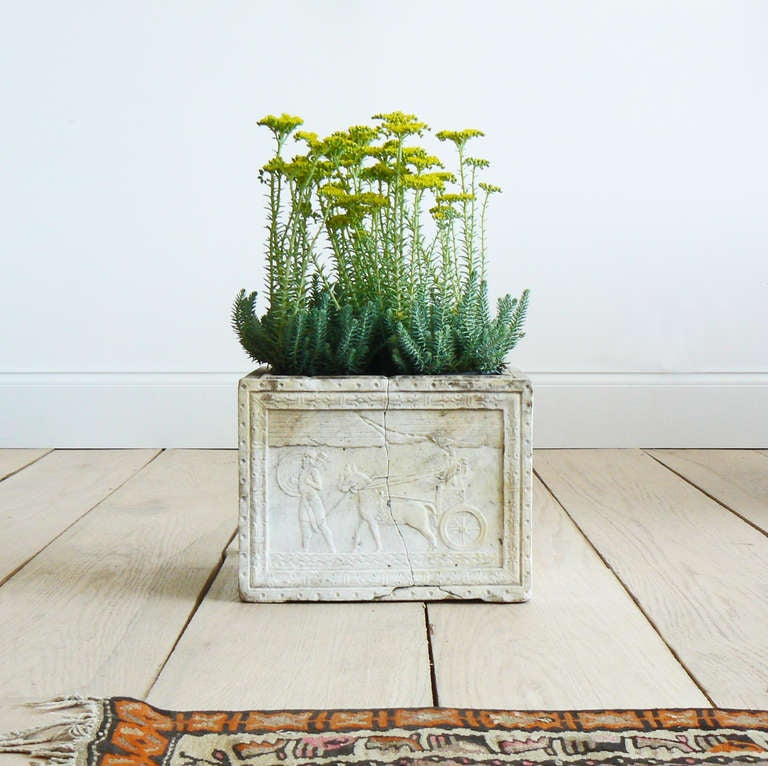 Though the form of this planter is typical of a Roman cinerary urn, the style of the carving is Neo-Assyrian, most likely dating from the 19th century and inspired by the publication of Austen Henry Layard's texts on his excavations at Nineveh. It