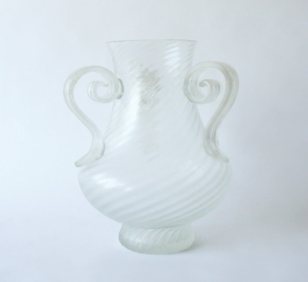 An impressive hand blown Murano glass vase with fluted body and three applied handles in the manner of Cenedese.