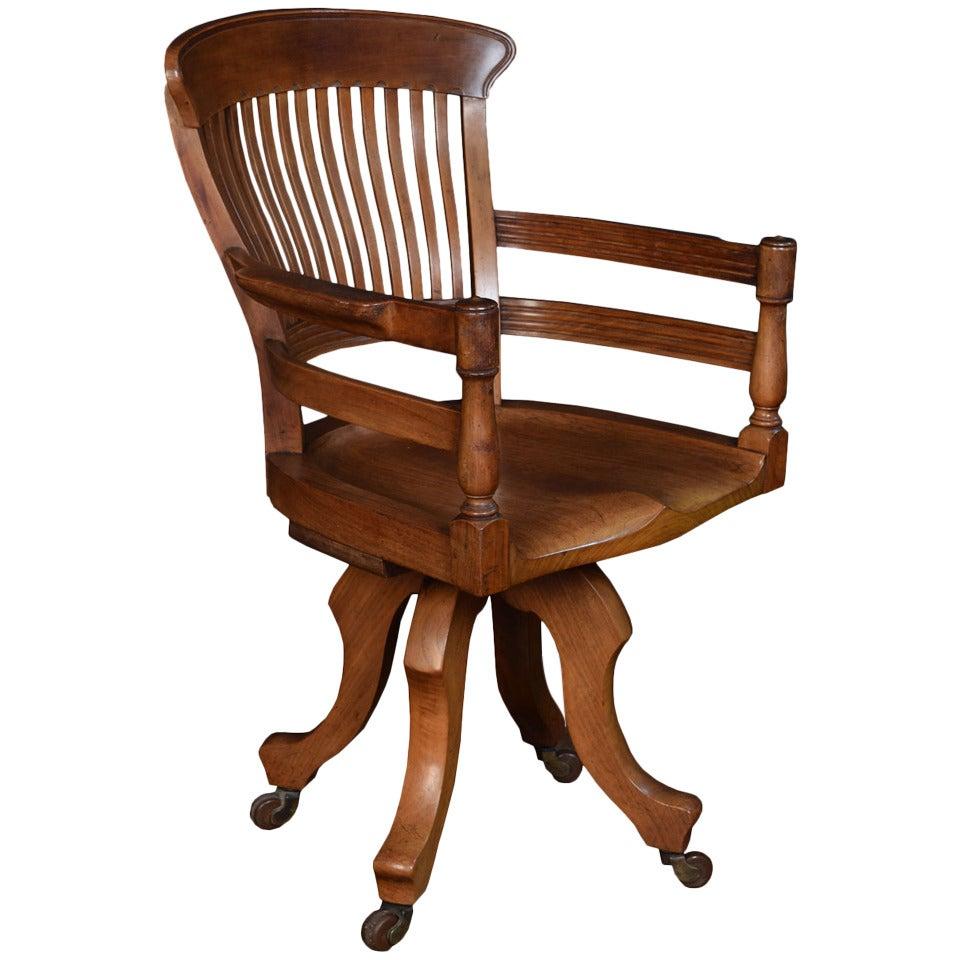 this walnut office captain s revolving desk chair is no longer