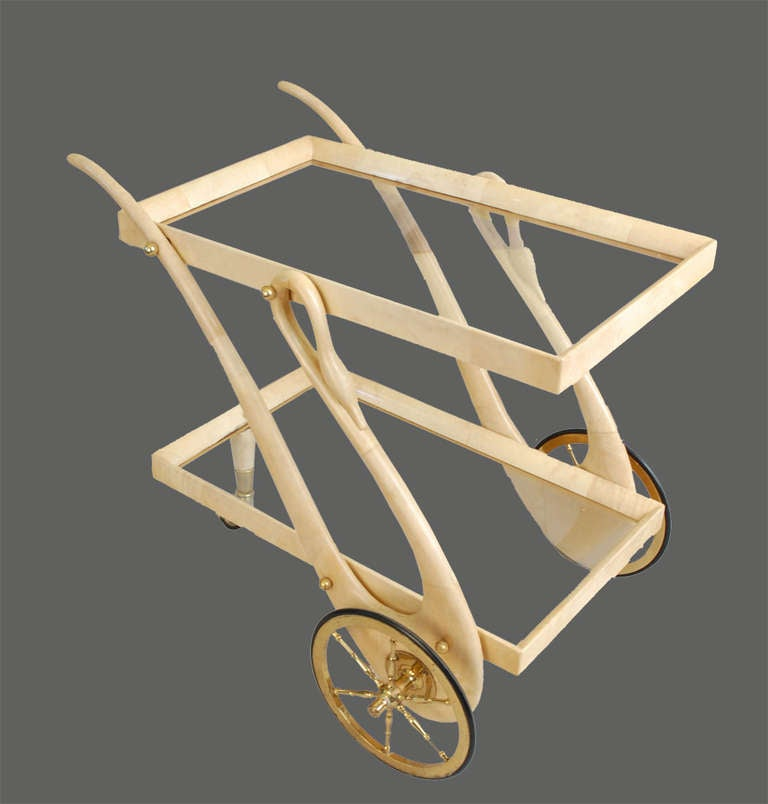 This is one of the most elegant carts ever designed by Aldo Tura, with the swan motif as handles and goatskin workmanship.