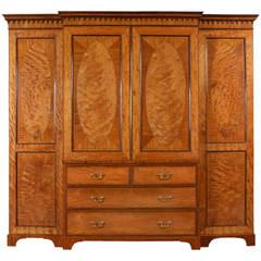 George III Satinwood four door breakfront wardrobe