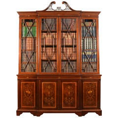 Mahogany breakfront bookcase by Edwards and Roberts