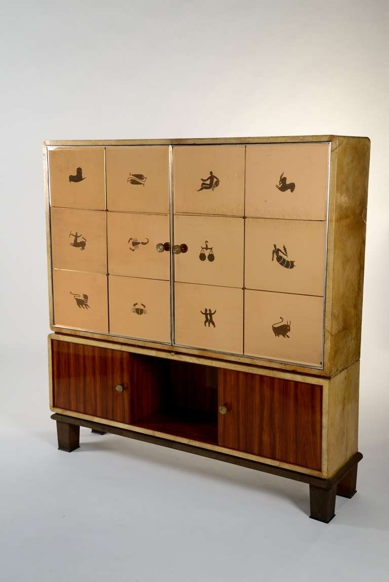 Extraordinary cabinet designed by Gio Ponti and manufactured by Paolo Lietti & Figli, Cantù in 1930. Doors made of twelve mirrors representing the zodiac and signed by Luigi Fontana. Sides are covered with white parchment, the base is made of