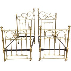 Antique Symmetrical Iron Frame Brass Beds