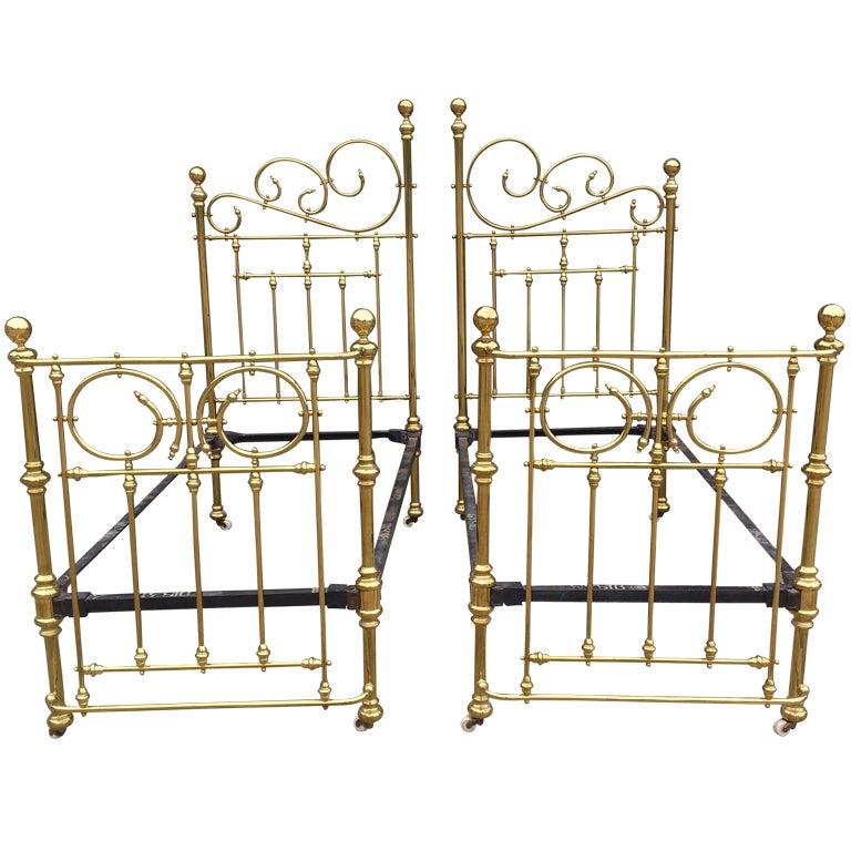 antique symmetrical iron frame brass beds 1 - Brass Beds