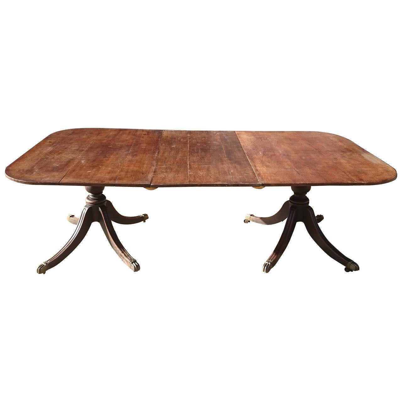 Early 19th century oak twin pillar dining table at 1stdibs for Pillar dining table