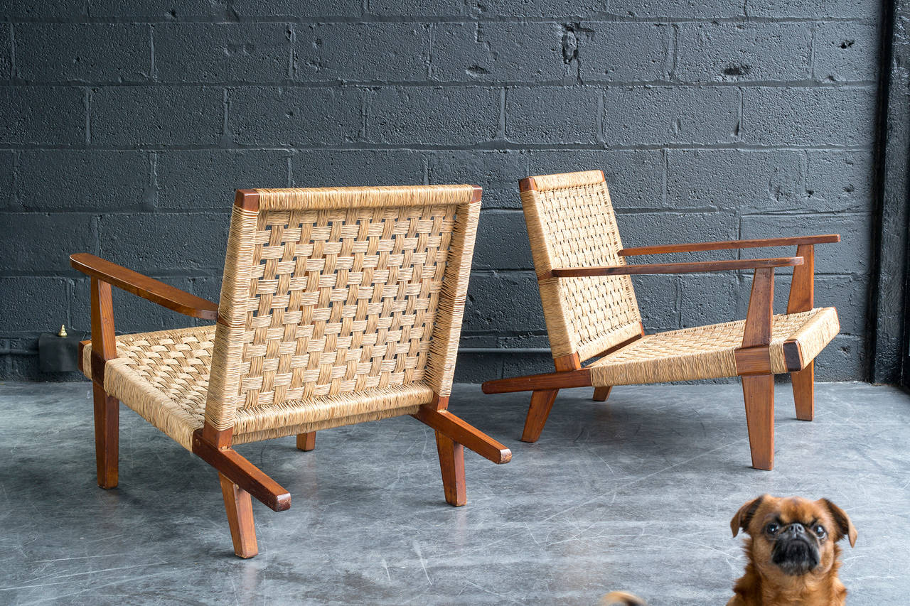 Rare form from Cuban-born designer, Clara Porset. Woven rush seat and back on wood frame.