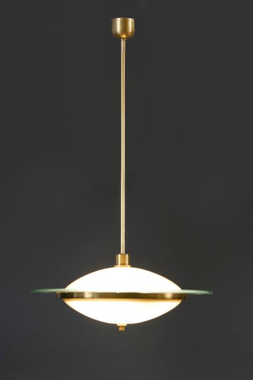 Elegant Fontana Arte chandelier with four internal lightbulbs.