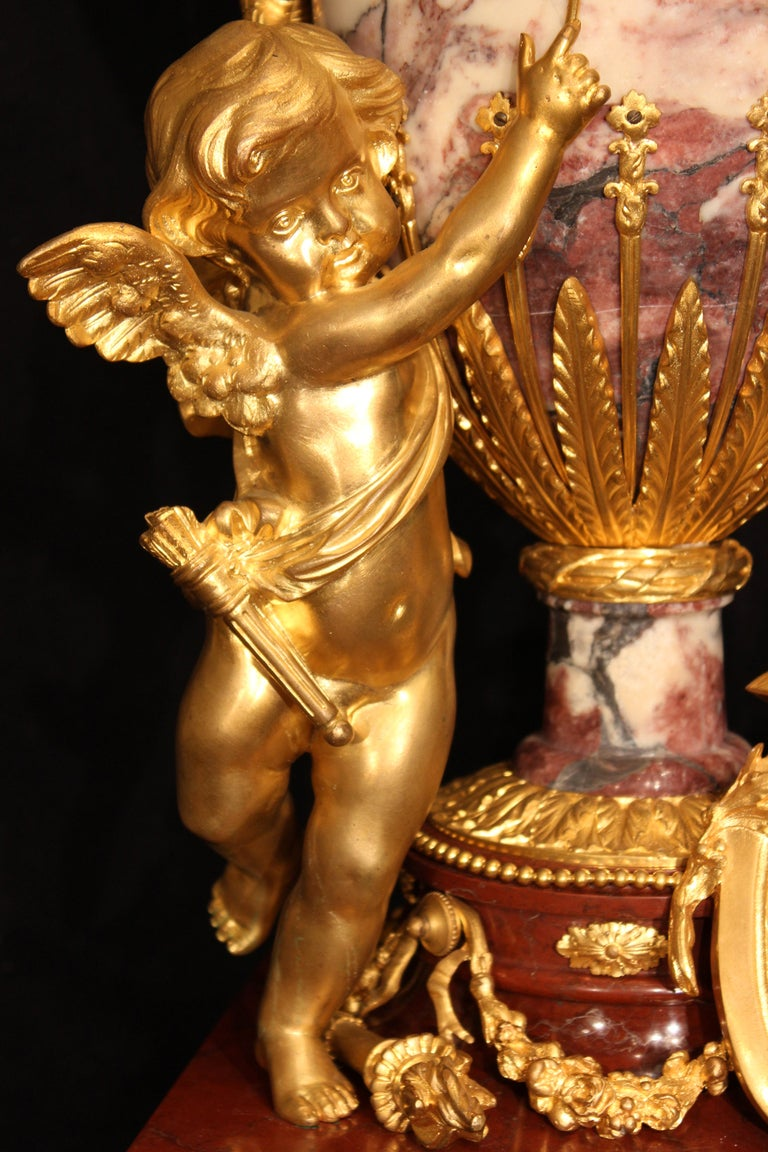 A magnificent French 19th century, circa 1850, Louis XVI st. marble and ormolu annular clock signed P. Bonfiglio. Raised on ormolu topie supports below the Rouge Griotte moulded marble base with an ormolu band of intertwined ribbon, laurel leaf and
