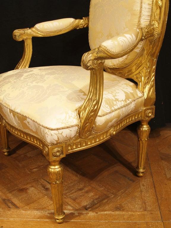 A pair of Italian Louis XVI st. giltwood armchairs 2