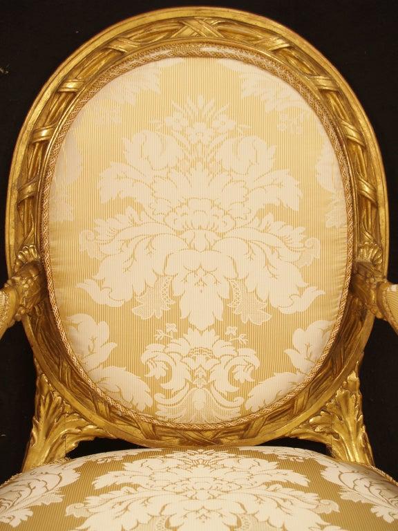 A pair of Italian Louis XVI st. giltwood armchairs 3