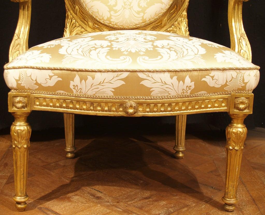 A pair of Italian Louis XVI st. giltwood armchairs 4