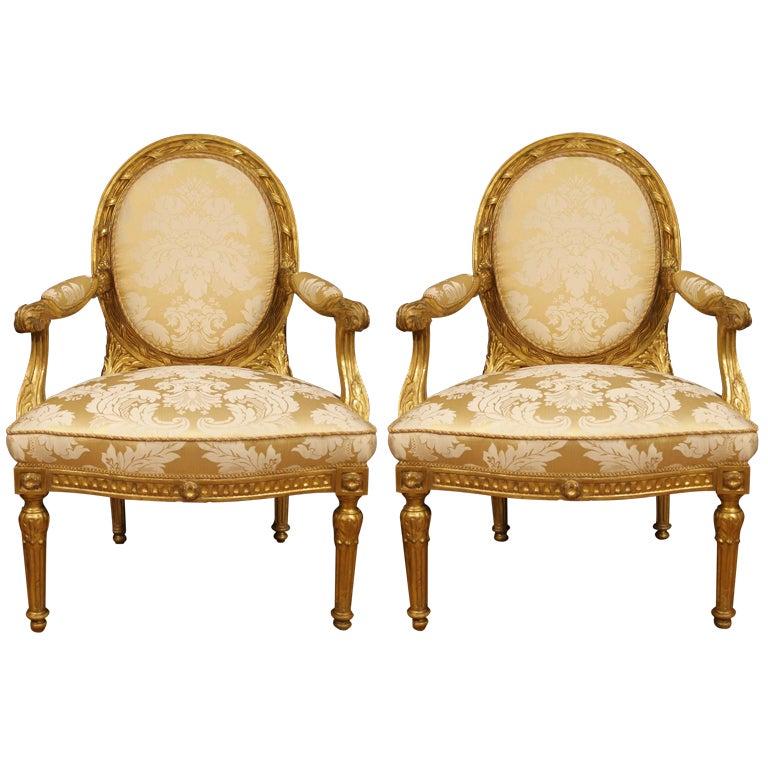 A pair of Italian Louis XVI st. giltwood armchairs 1