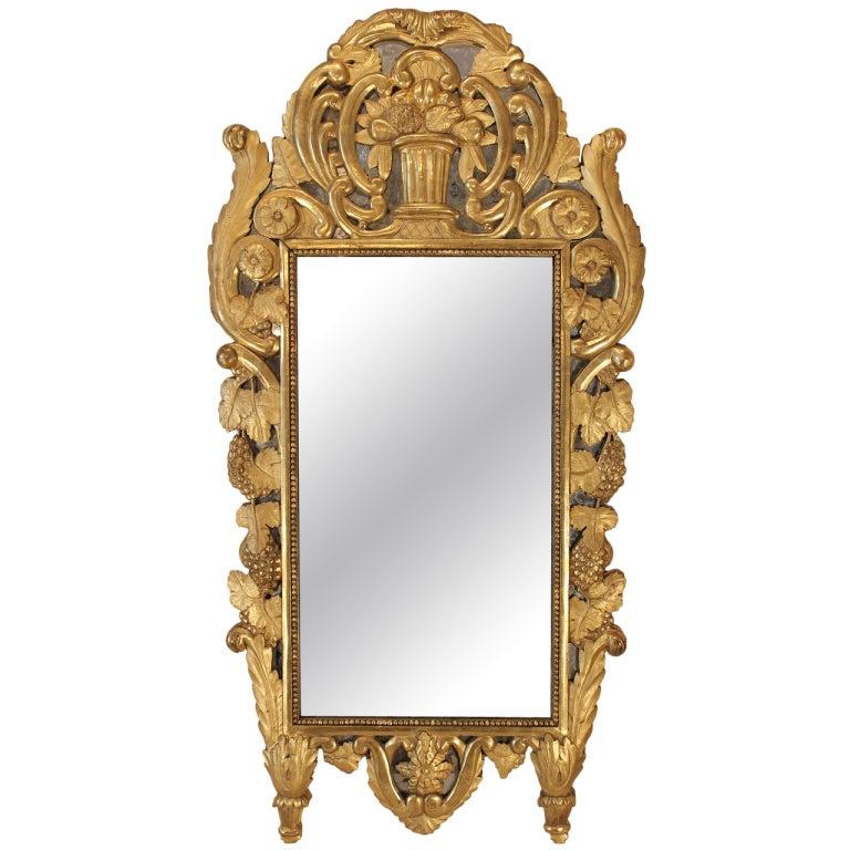 French mid 18th century, circa 1740, Provencial giltwood mirror