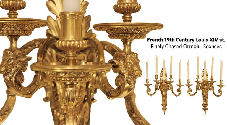 An impressive large scale pair of mid 19th century French Louis XIV st. ormolu five arm sconces. The richly chased pair with all original gilt has a back plate decorated by large acanthus leaves, and a central female figure with her hair braided
