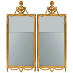 A  pair of Italian 19th century Louis XVI st. giltwood mirrors