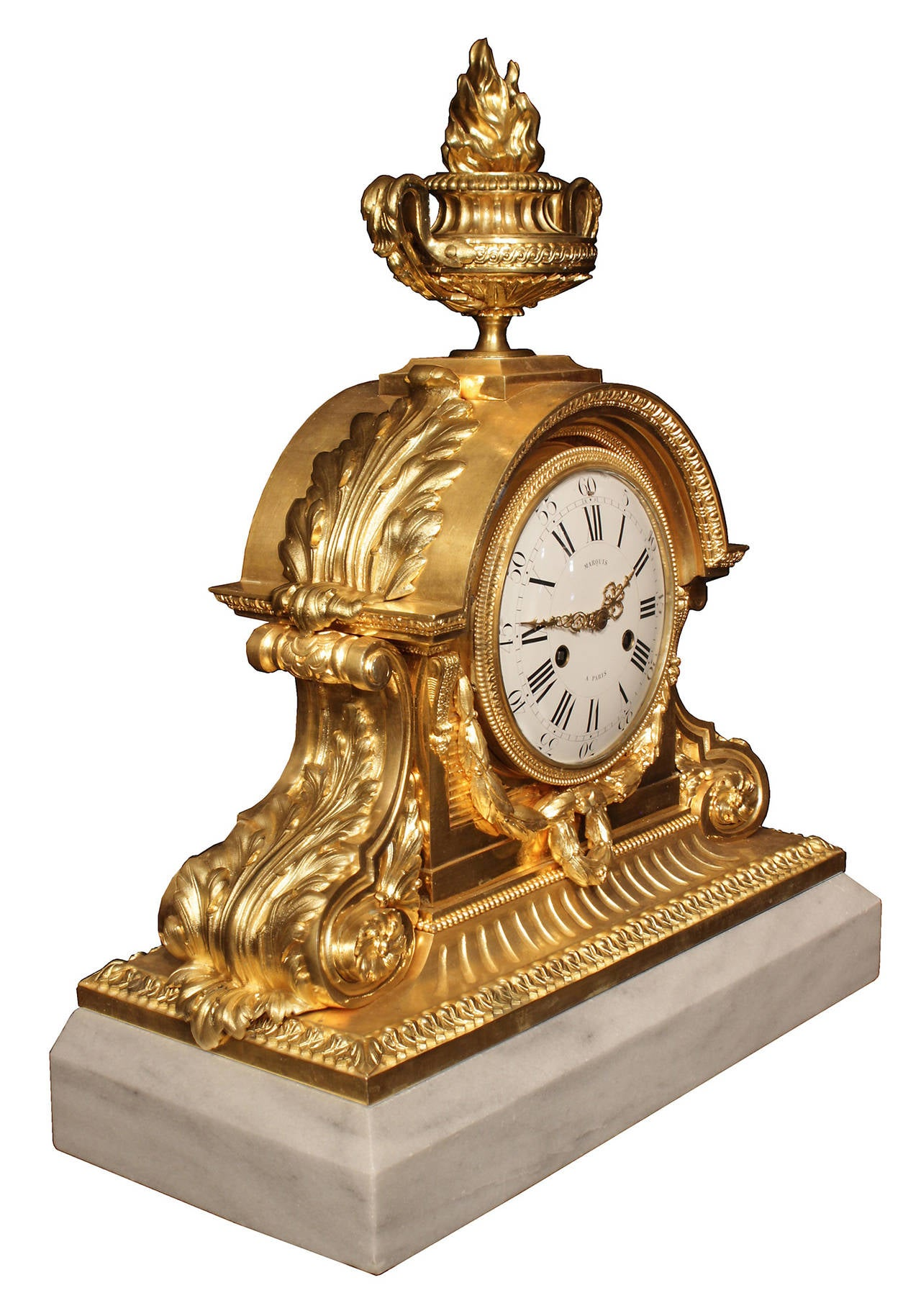 A striking and grand scale French 19th century Louis XVI st. ormolu and marble clock, signed Marquis à Paris. The mechanism is manufactured by Honoré Pons. The clock is raised on an impressive solid white Carrara marble rectangular base with a cut