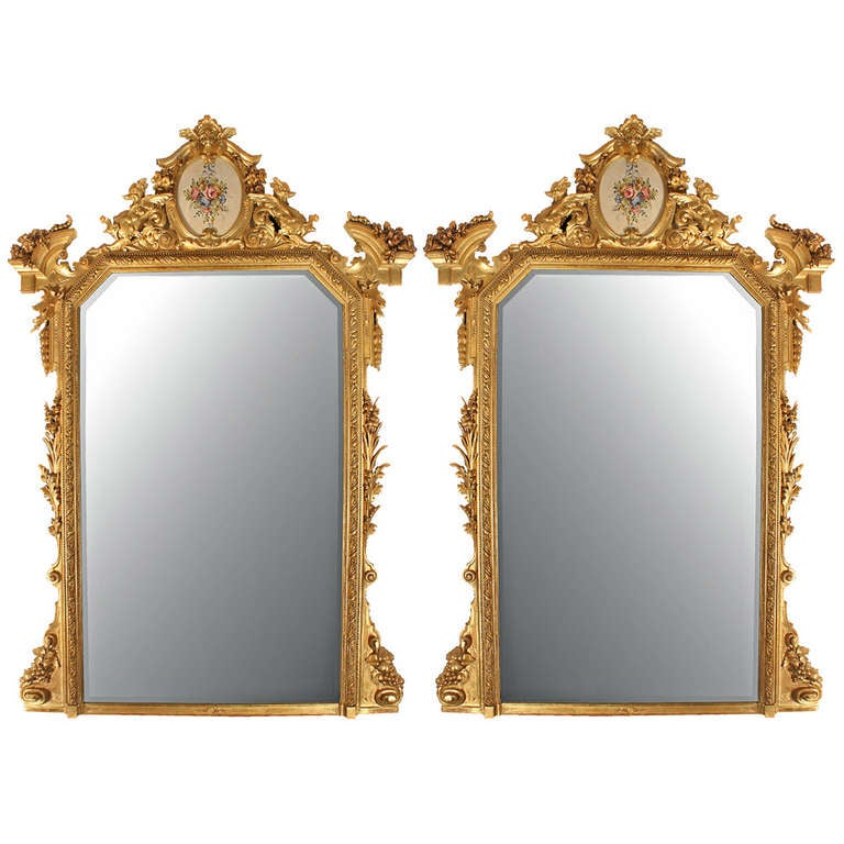 A magnificent pair of Italian 19th century Lombardi giltwood mirrors