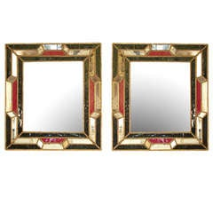 A pair of early 19th century Italian mirrors with red and dark blue glass