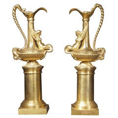 A pair of French Directoire period ormolu ewers