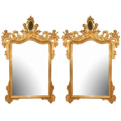 A pair of Italian 19th century richly carved giltwood mirrors
