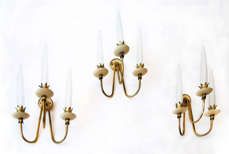 Rare set of three Angelo Lelli wall lights.   Each lamp three lights, by Arredoluce, Italy, 1950.  Polished brass, and painted opaline tubular glass.   Measures: H 42 cm, 32 x 20 cm each.