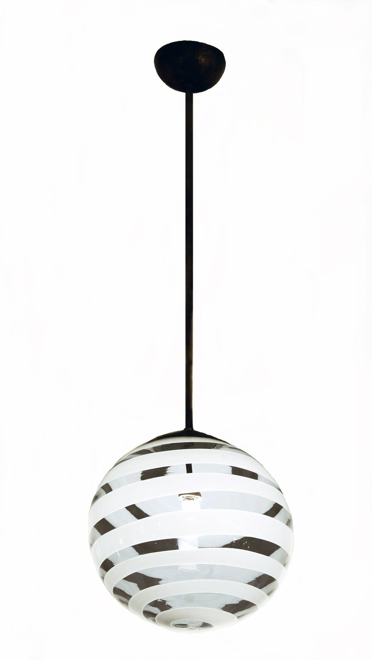 "Carlo Scarpa ceiling lamp 1938   Ceiling lamp designed by Carlo Scarpa and manufactured by Venini Murano  Clear and Lattimo "" a fasce"" glass exhecuted by Venini Murano   Measures: h 100cm x 32 cm (diam.) Literature: Anna Venini Diaz De"