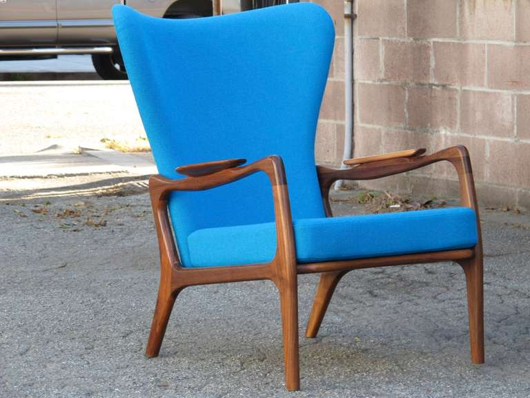 High-back lounge chair designed by Adrian Pearsall for Craft Associates. Sculptural walnut frame newly upholstered in an aqua blue wool textile. Swatches available upon request.