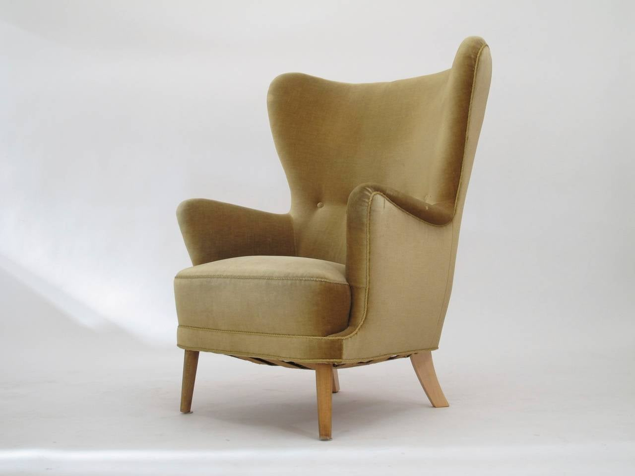 Sculptural Mid-Century Danish high back lounge chair in manner of Jacob Kjær. Constructed of solid wood frame with hand tied springs and horsehair padding, upholstered in original mohair fabric. Excellent back support and comfortable seating.