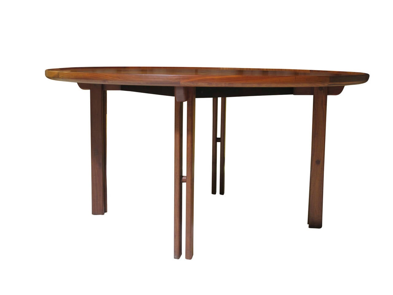 Walnut round coffee table with raised edge and ebony inlay in centre; raised on solid walnut sculpted legs.