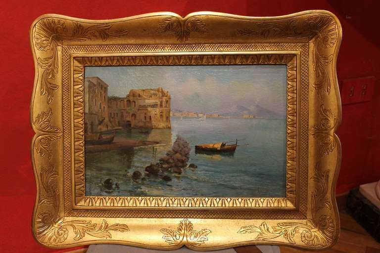 This very fine late 19th Century oil on canvas seascape painting depicting a marine landscape with rowing boats and a palace is signed lower right by Oscar Ricciardi (Naples 1864 – 1935), a talented painter who joined the School of Posillipo. This