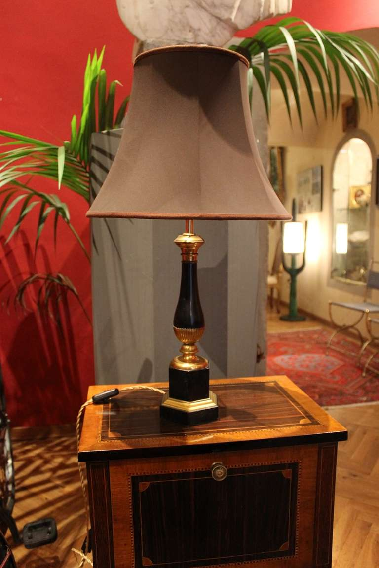A beautiful pair of French Empire style 19th century lacquered and gilt bronze table lamps.