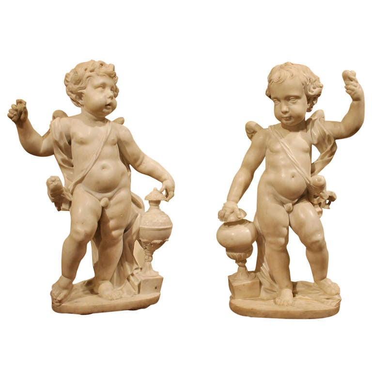 A. Lazzoni a Pair of 17th Century White Carrara Marble Putti Sculptures
