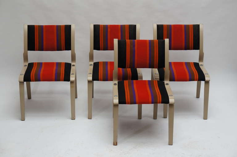Beautifully shaped wooden chairs with original and typical seventies upholstery. The wood has been painted. These have that