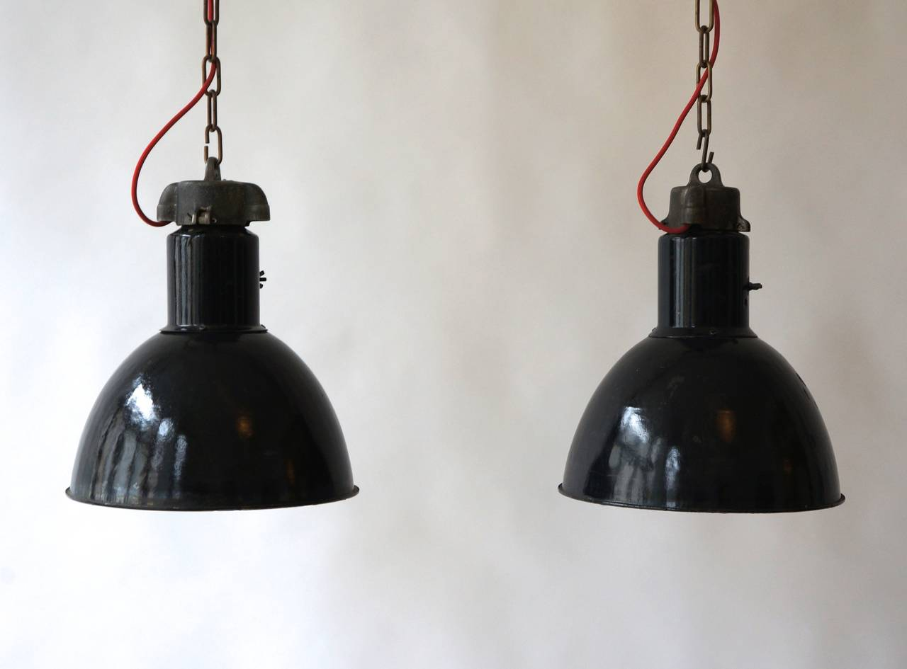 A pair of black enameled Industrial pendants.