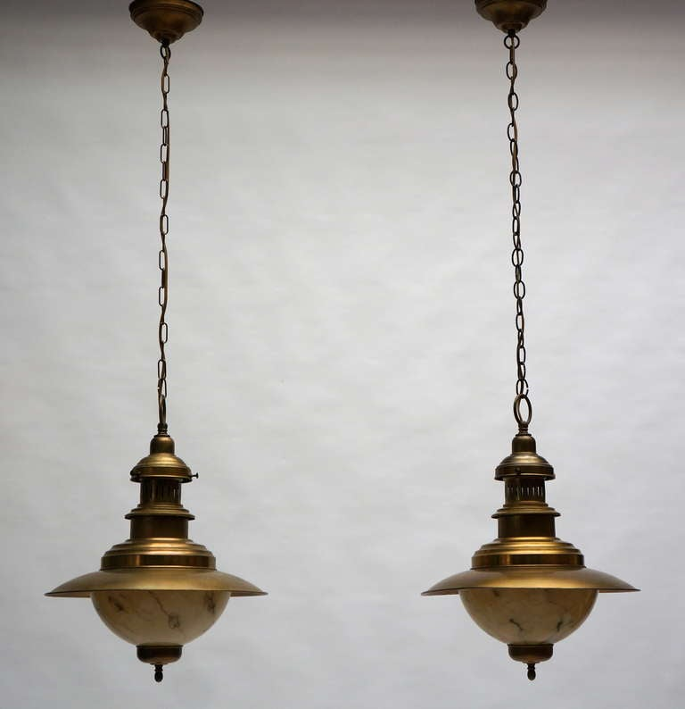 A pair of brass chandeliers.