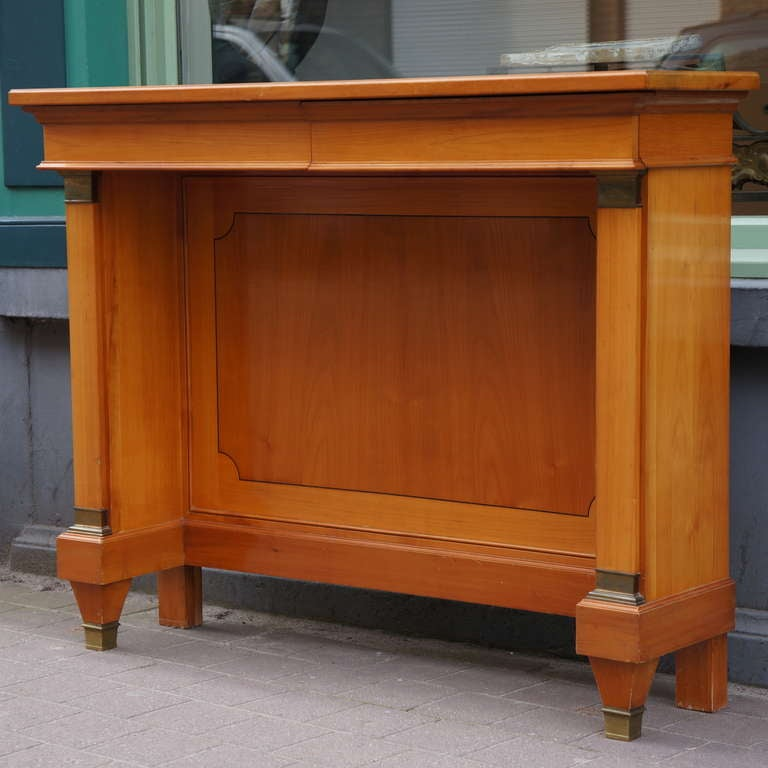 A fine neoclassical cherry wood console,Belgium. Period: early 1950s.  In good original condition with bronze details. Width:120 cm. Height:96 cm. Depth:34 cm.