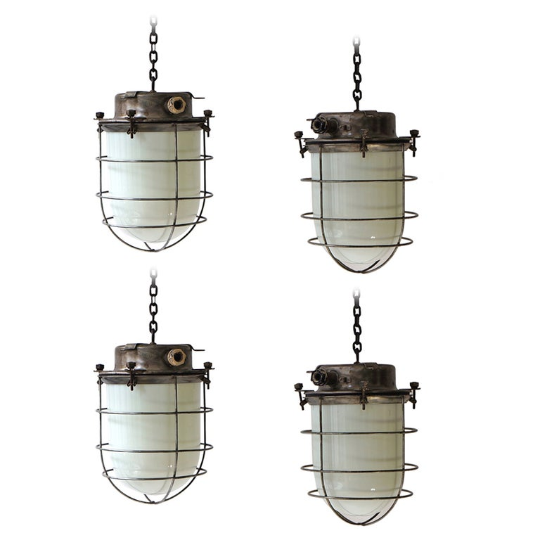 Four Vintage Industrial Hanging Lamps For Sale