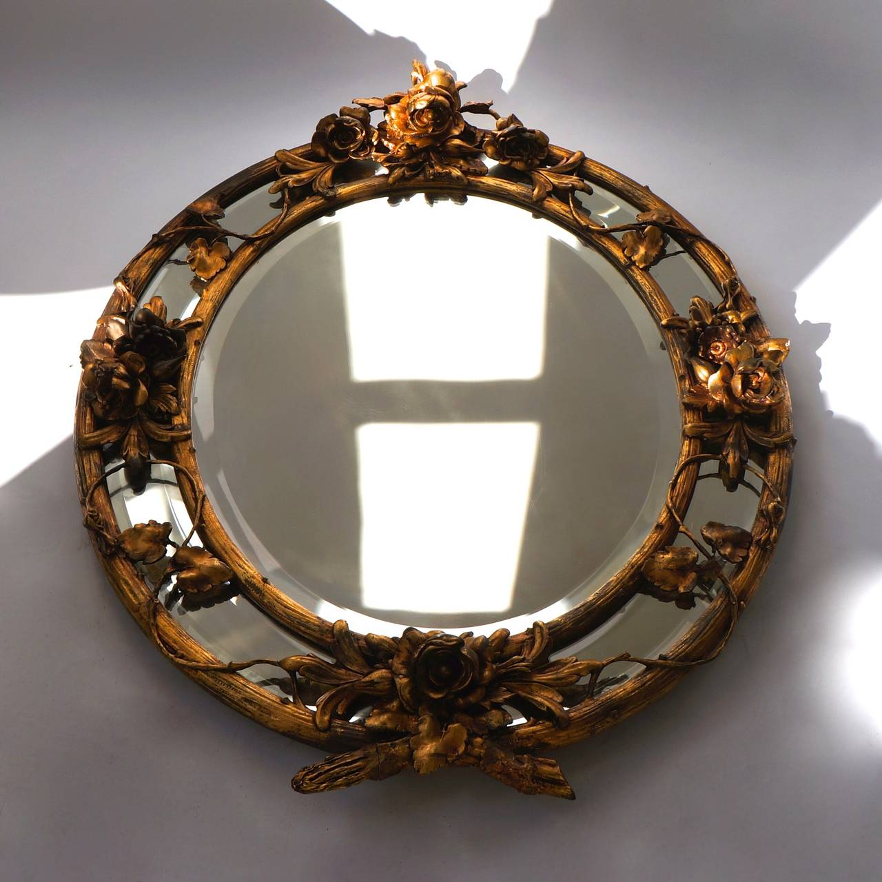 A lovely Rococo wall mirror with the original gilt, showing some loss. Lots of good details, a Classic beauty.