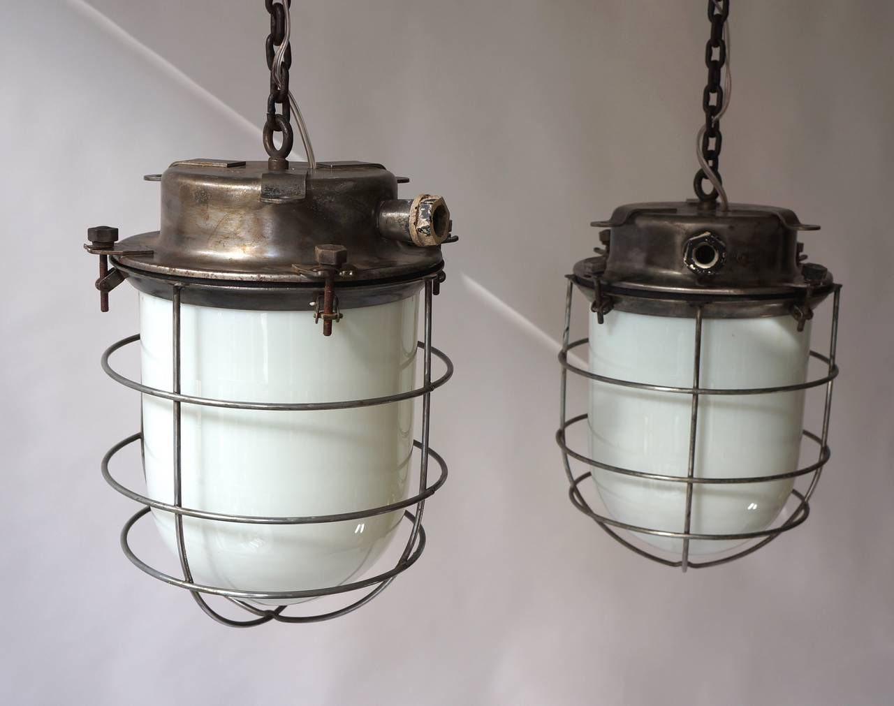 Four vintage Industrial hanging lamps.