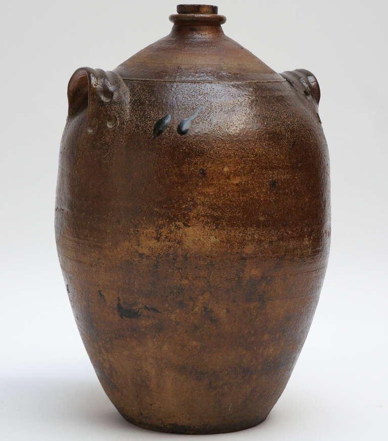 A glazed stoneware jug.