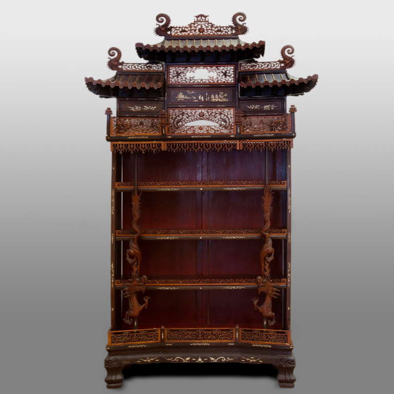 Made of different species of tropical hardwood, carved with transparent scrollwork fences and panels, two dragons in the front and pagoda roofs on top. Mother-of-pearl inlays on the sides, bottom and roof panels. A magnificent realisation of the