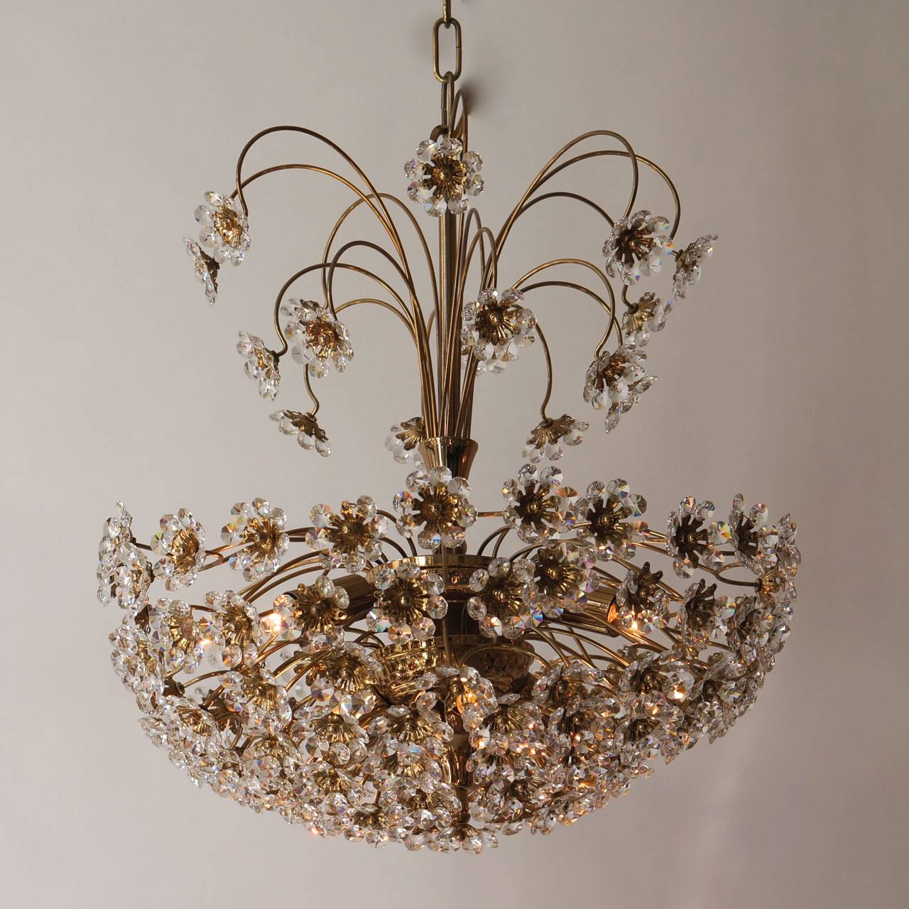Palwa gilt brass and crystal flower chandelier.1970s Six E14 bulbs. Total height with chain 120 cm.
