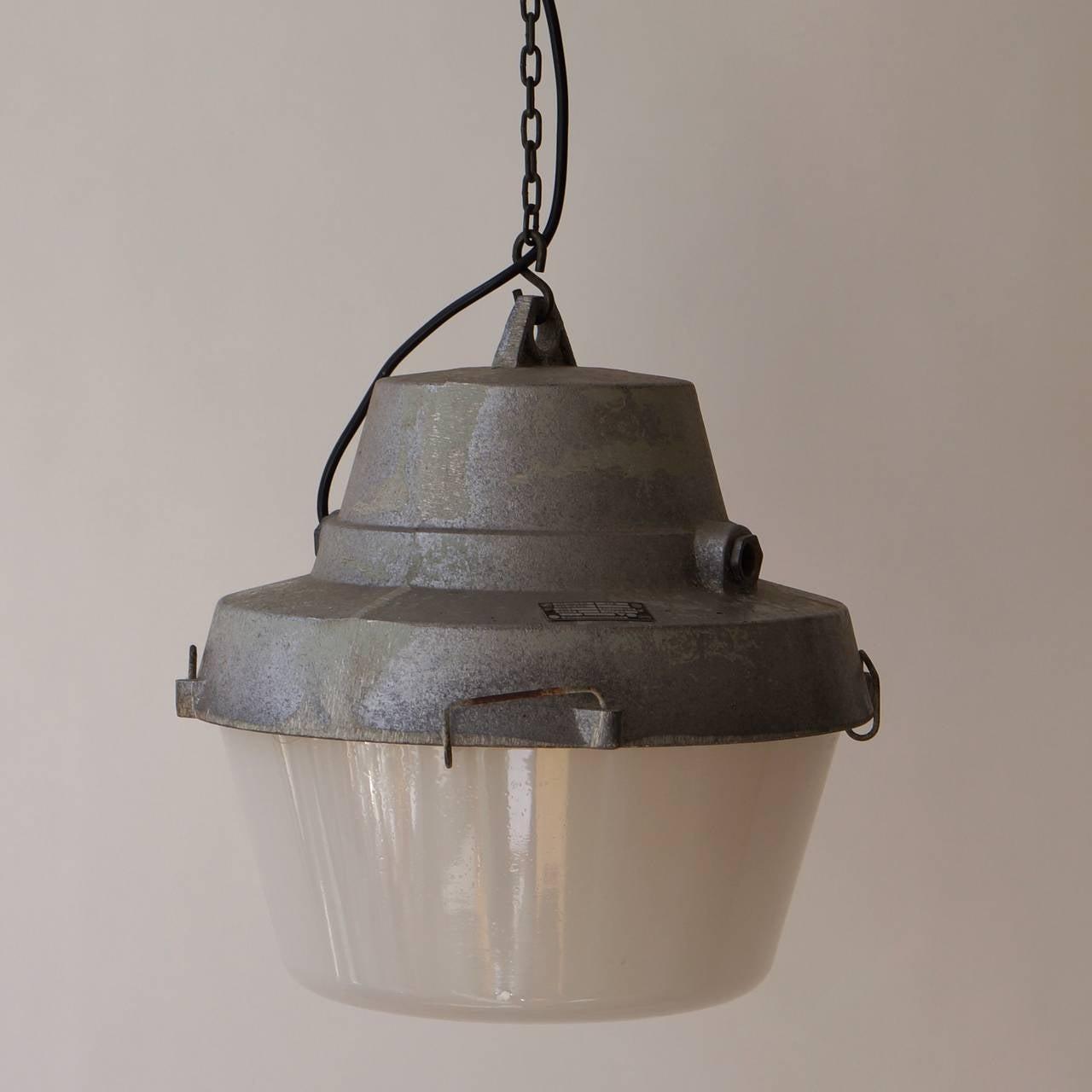 Set of five Industrial pendant lights.