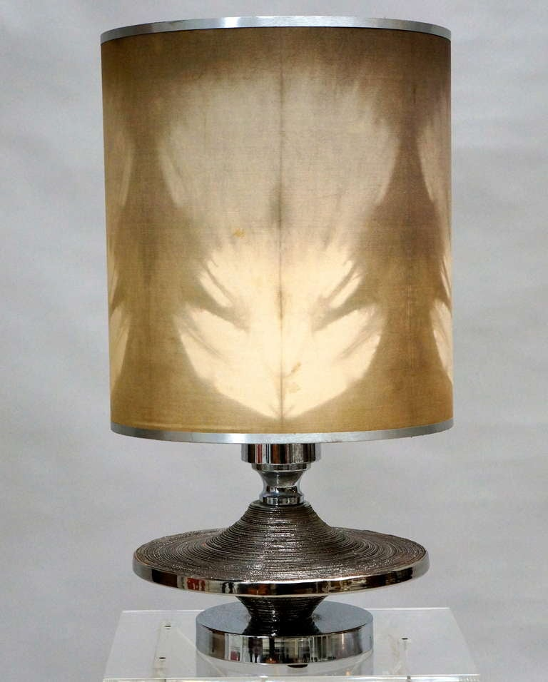Italy, 1970s. Large sculptural table lamp in ceramic with reflective silver base.