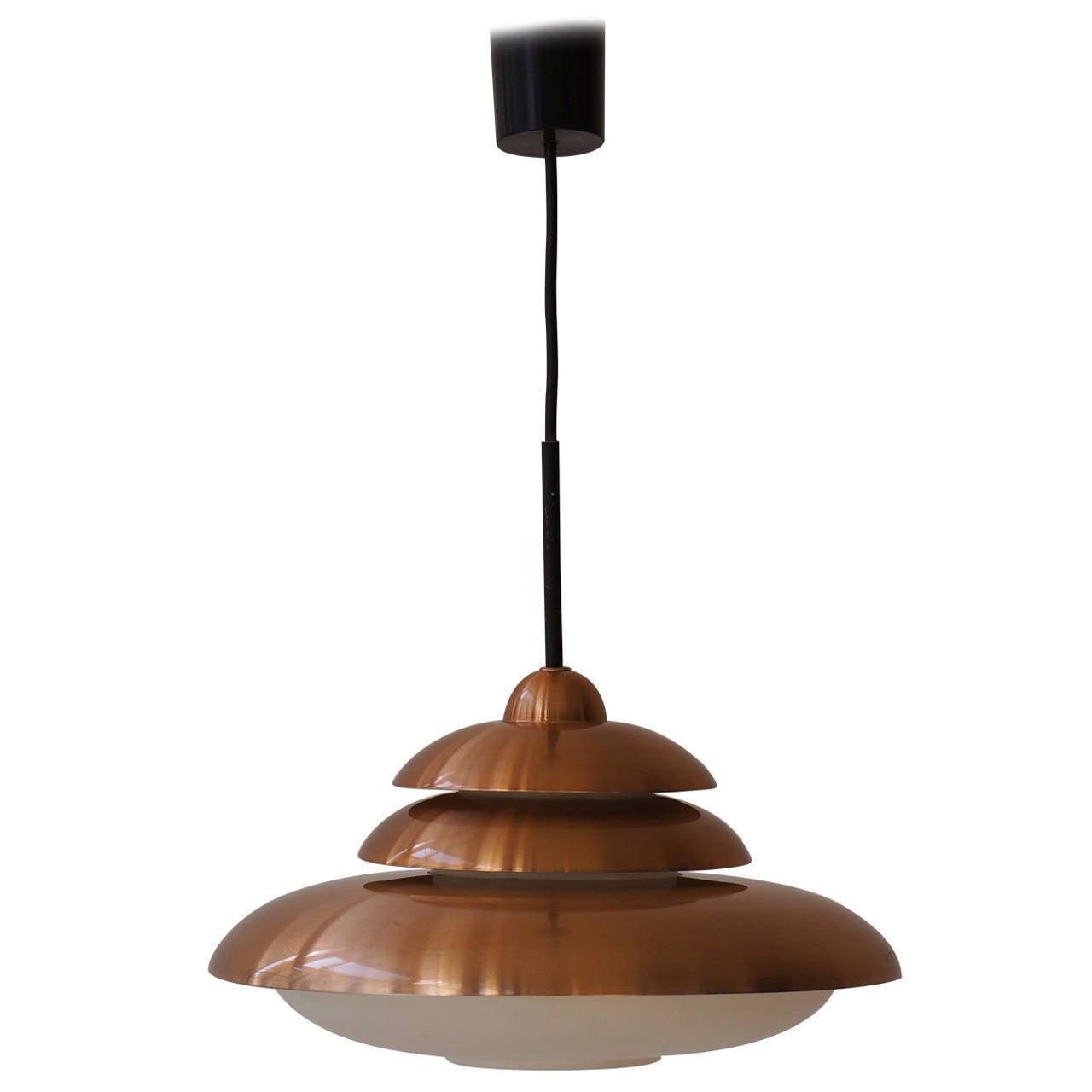Doria opaline and copper pendant light.
