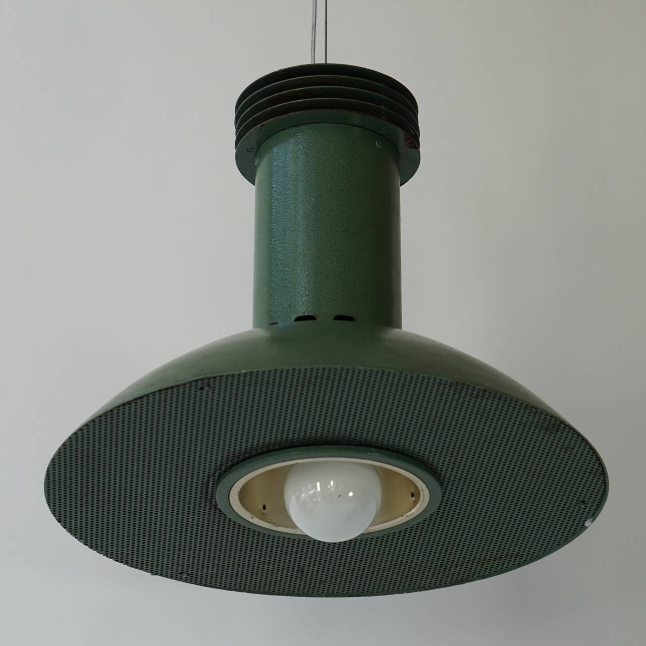 One green metal Industrial light with one E27 bulb.